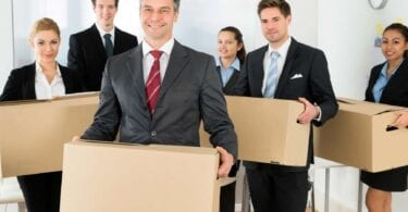 Employees-In-Office-Holding-Cardboard-Boxes