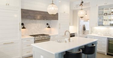 White Kitchen with black bar stools