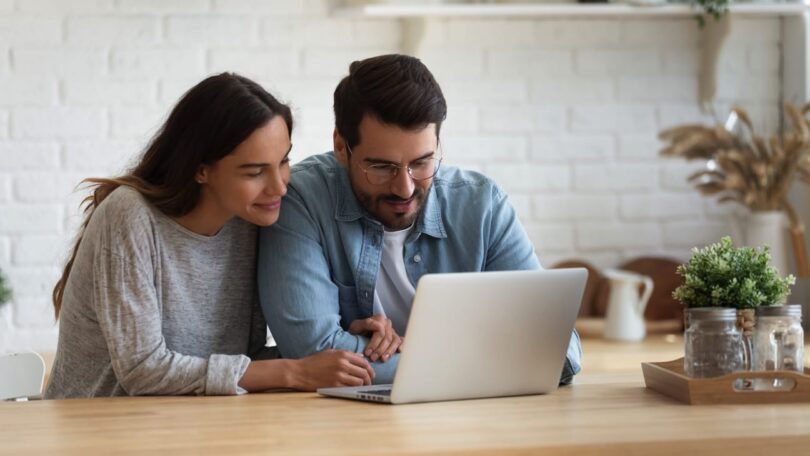 couple looking at a computer screen