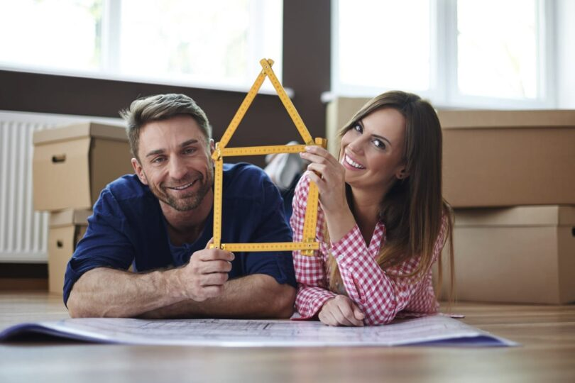 Couple holding a measurement tape