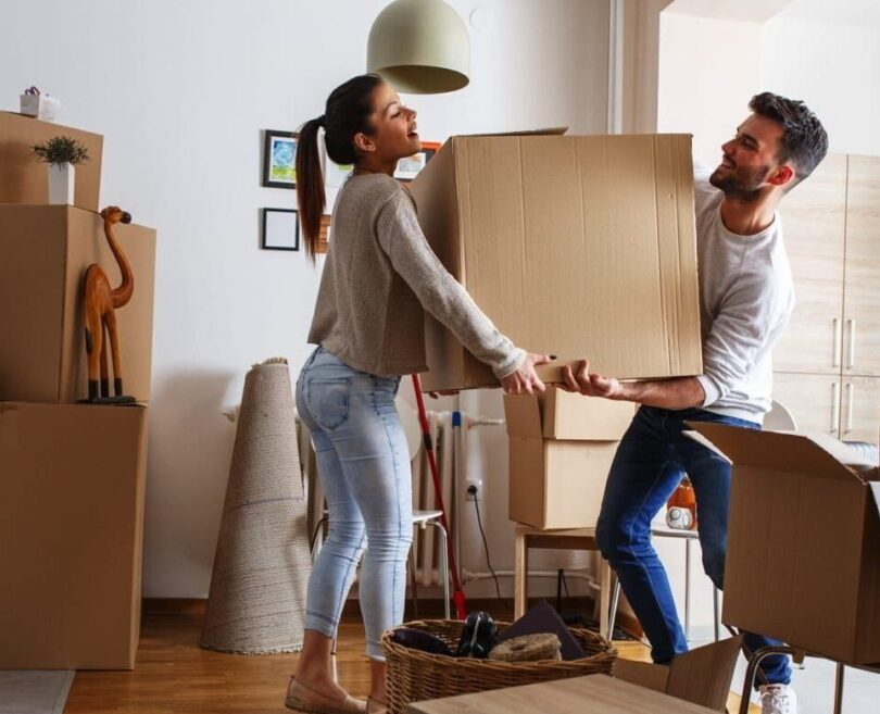 couple moving a box