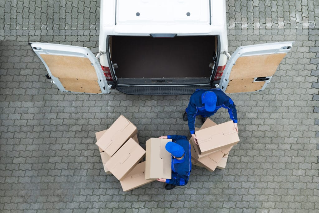 aerial photo of movers with boxes at moving truck