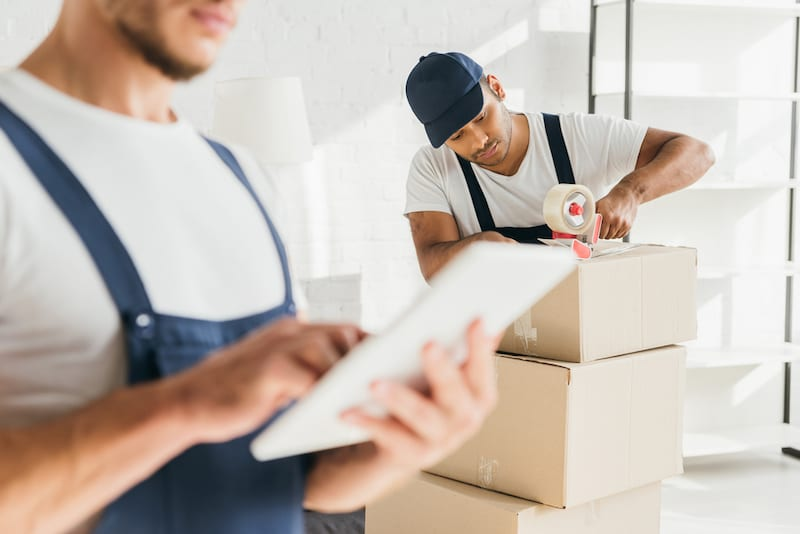 movers packing boxes and keeping inventory