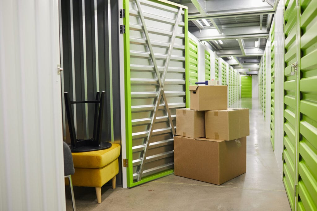 moving boxes outside of a storage unit with an open door