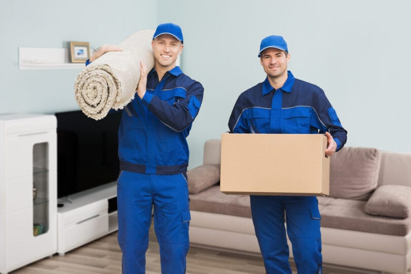 moving men with box and carpet