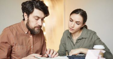 couple calculating moving costs