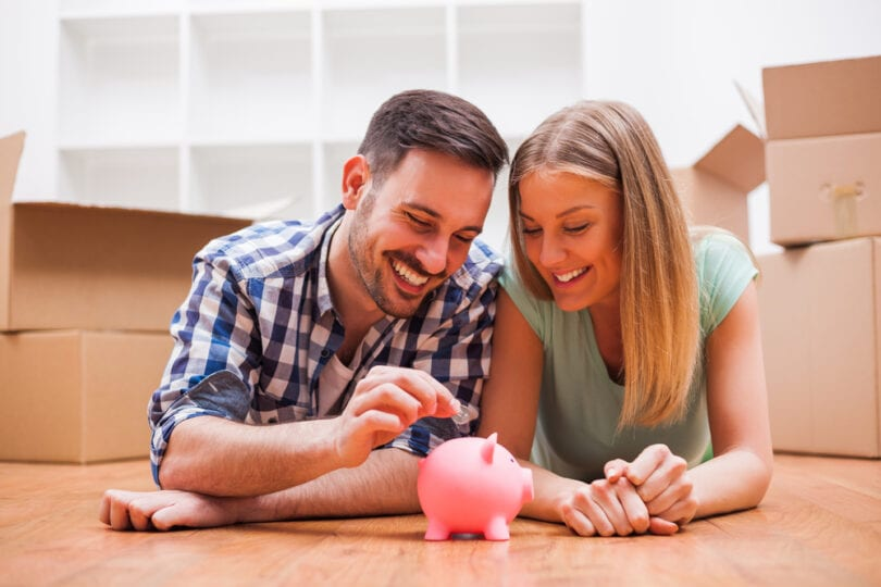 couple saving money in piggy bank