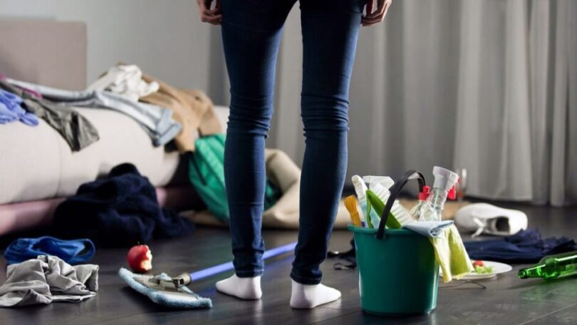 woman standing in messy room