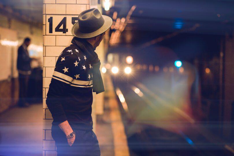 man waiting for subway