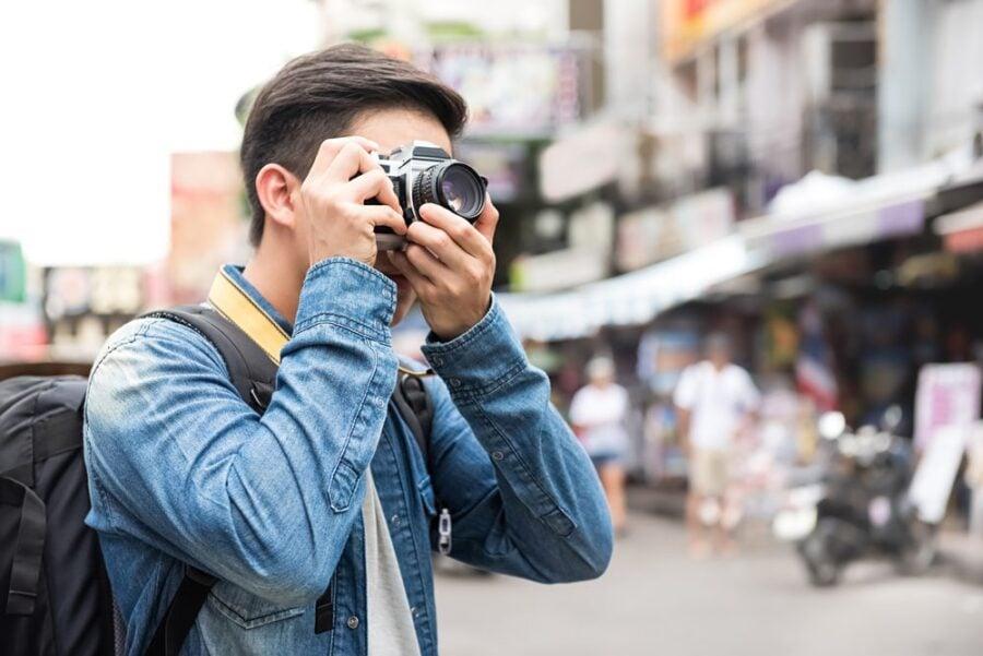 tourist man with camera