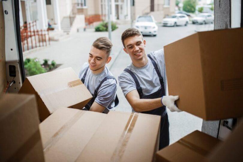 Two men loading moving truck