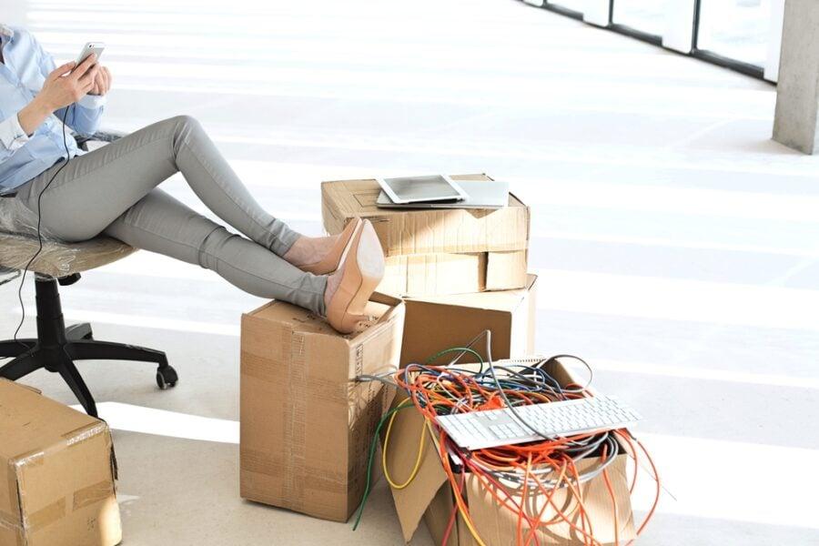 woman on phone box of it equipment