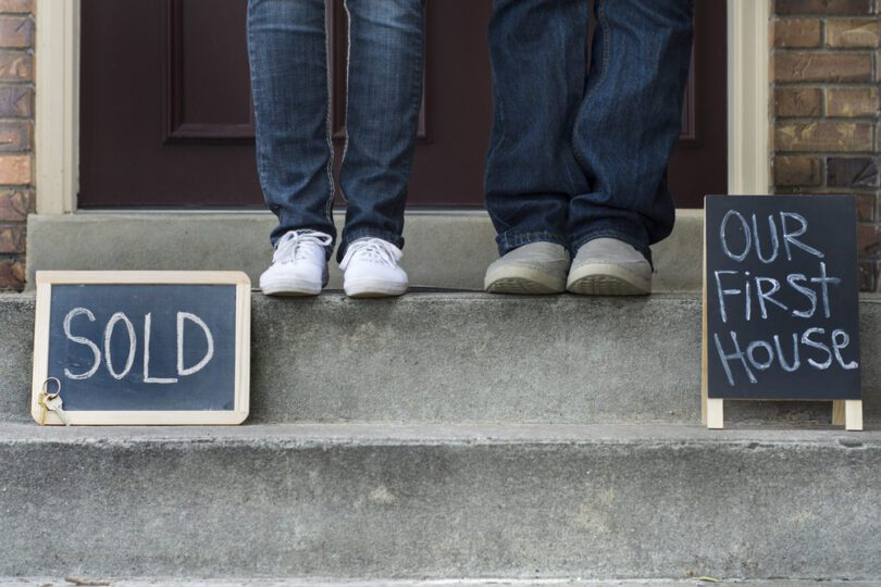 couple on doorstep home sold