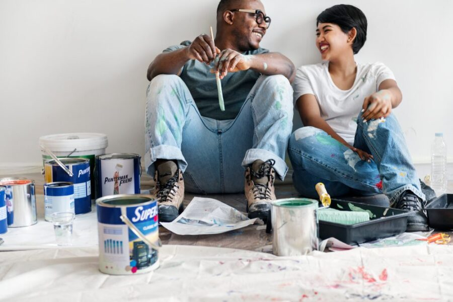 young couple with house paint